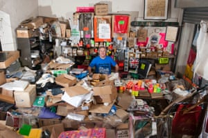 Paul Gardner sits amid the apparent jumble of his specialist paper bag shop