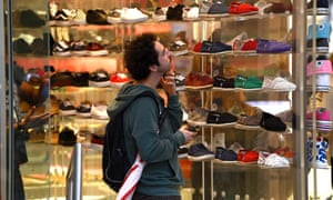A person shops for shoes at Queens Street Mall in Brisbane