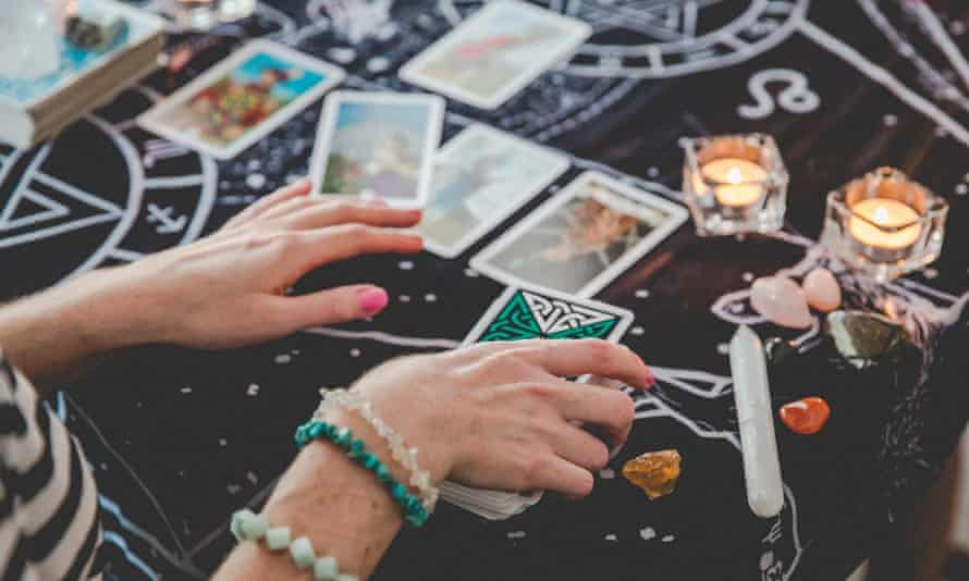 A tarot card reader 'manifesting magic'.