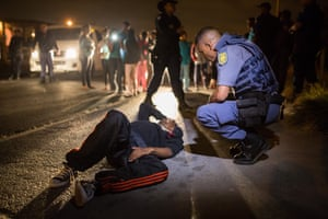 In 2011 a special, cross-departmental unit known as the Cape Town Metro Police Gang and Drug Task Team was formed to step in where previous units and the police had failed. Police tend to a man who was shot in the leg just minutes earlier in an alleged drive-by shooting in Lavender Hill, Cape Town