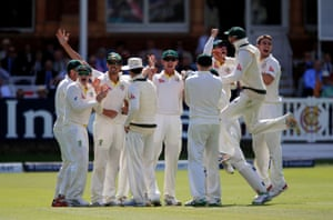 Australia celebrate after watching the big TV screen to see the run out of Ben Stokes with a direct throw.
