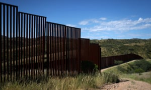 Sections of the US border wall with Mexico in Nogales, Arizona. A new report documents instances showing the dangers such walls pose to humans and the environment.