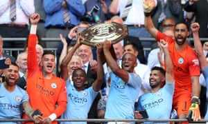Fernandinho and Vincent Kompany (centre) lift the Community Shield after beating Chelsea 2-0 at Wembley.