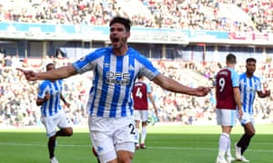 Christopher Schindler celebrates scoring Huddersfield's opening goal against Burnley.