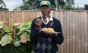 Ken Morgan tucks in to his fish and chips on his first day back in the UK