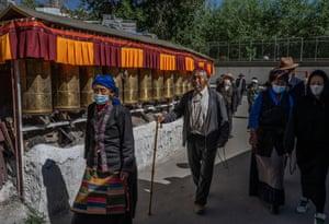 Tibetan Buddhists walk the kora at a local shrine