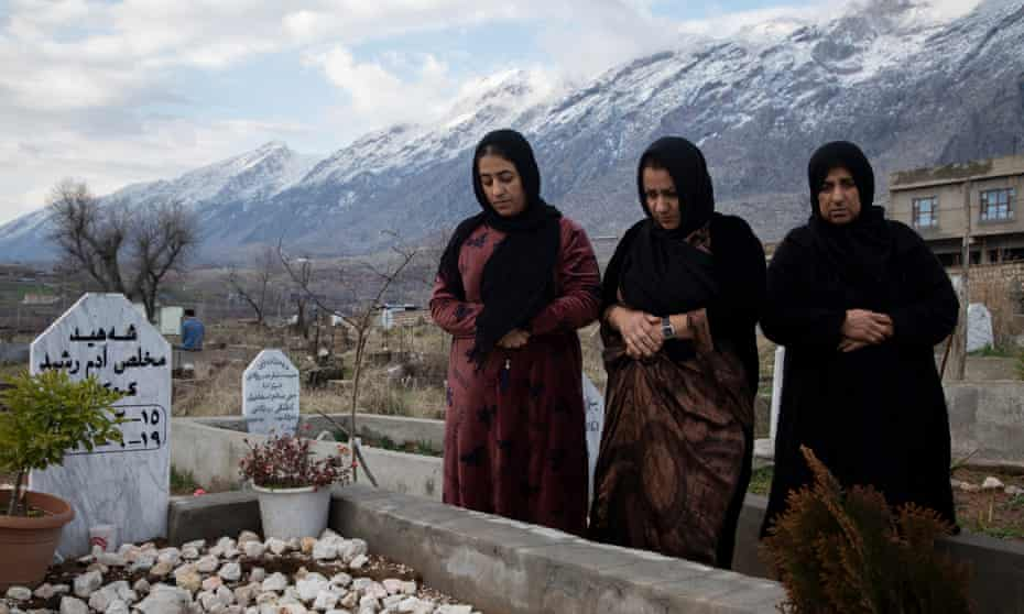 Mukhlis Adam's mother and sisters at his grave in Sheladze. Adam was killed by an airstrike in June 2020, aged 28.