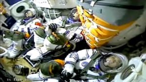 Astronauts Nie Haisheng, Liu Boming, and Tang Hongbo are seen in a capsule as China launches the Shenzhou-12 spacecraft