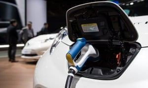 An electric vehicle charger is displayed at the Paris Motor Show