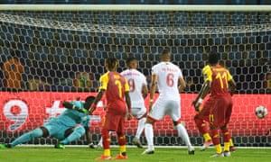 Ghana's goalkeeper Richard Ofori (left) concedes a goal.