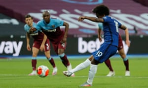 Chelsea's Willian shoots and scores the opening goal of the game from the penalty spot.
