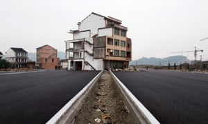 A half-demolished 'nail house' in the middle of a newly built road in Wenling. A couple in their 60s waged a four-year battle against change before their home was knocked down.