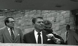 Ronald Reagan is shot and wounded by John Hinckley Jr, while leaving the Washington Hilton Hotel on 30 March 1981.