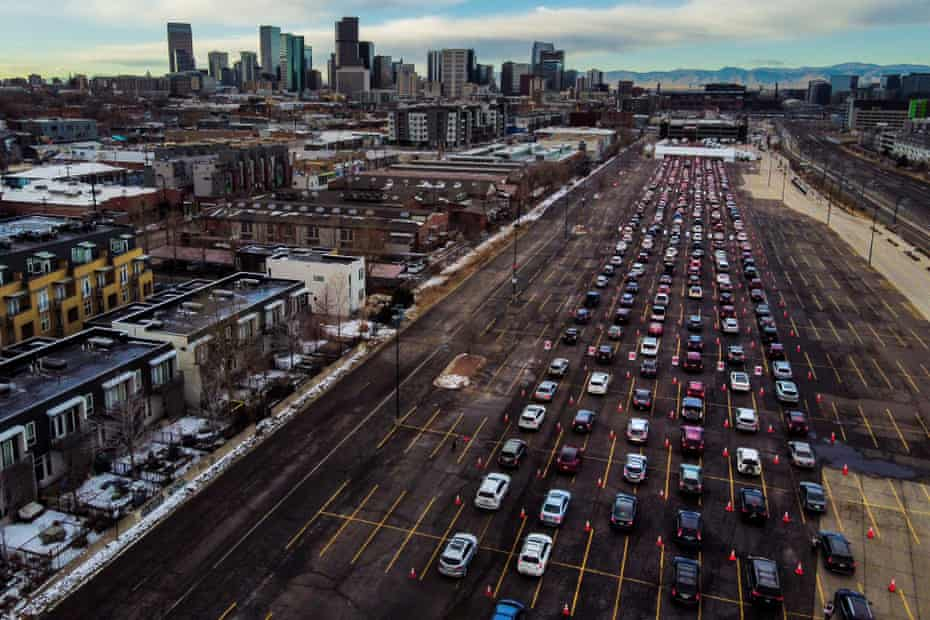 Cars line up for a mass Covid-19 vaccination event in Denver, Colorado.