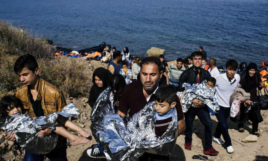 Migrants and refugees arrive at the Greek island of Lesbos after crossing the Aegean on Sunday