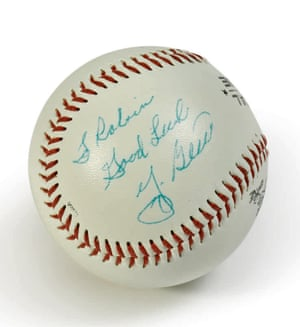 "A baseball ball signed: ""To Robin, Good Luck, Yogi Berra"""