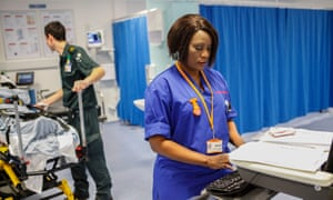 Nurse Catherine Chipande works late into the night at University Hospital, Southampton, in the Accident and Emergency Department.