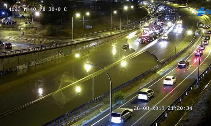 A CCTV image shows cars stranded on the flooded M40 ring road in Madrid