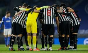 Newcastle United players huddle