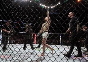 Conor McGregor enters the octagon.