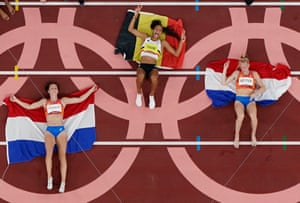Gold medallist Nafissatou Thiam of Belgium celebrates with silver medallist, Anouk Vetter of the Netherlands and bronze medallist, Emma Oosterwegel of the Netherlands.