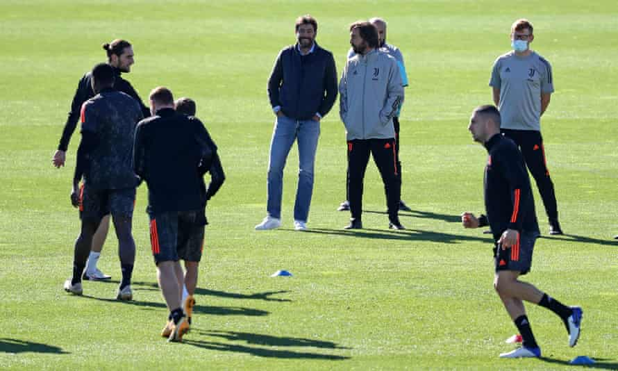Andrea Agnelli, CEO of Juventus, talks to Andrea Pirlo in training for a Champions League game against Barcelona in October 2020