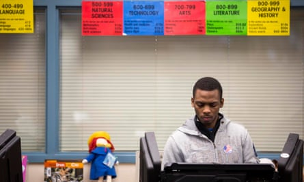 A young voter casts his ballot in Ferguson, Missouri.
