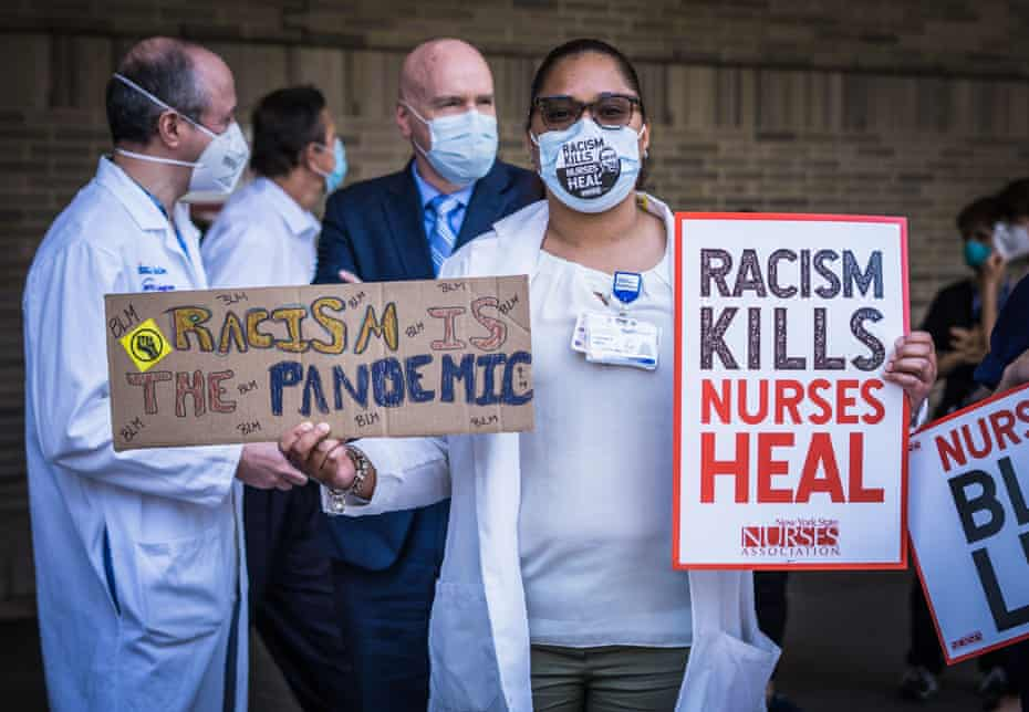 Nurses take a stand for racial justice outside of Bellevue hospital in New York City, in June.