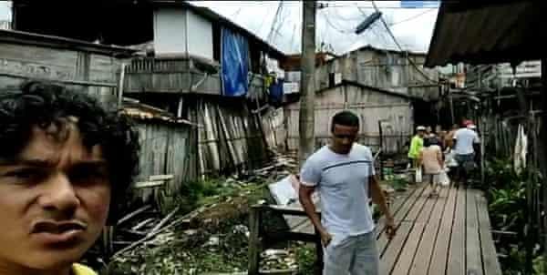 Renato Rosas, left, helps with food distribution