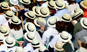 Spectators attempt to keep cool in the heat in the Roland Garros.