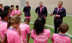 Former Australia spinner Shane Warne talks with children from the Rajasthan Royals UK academy.