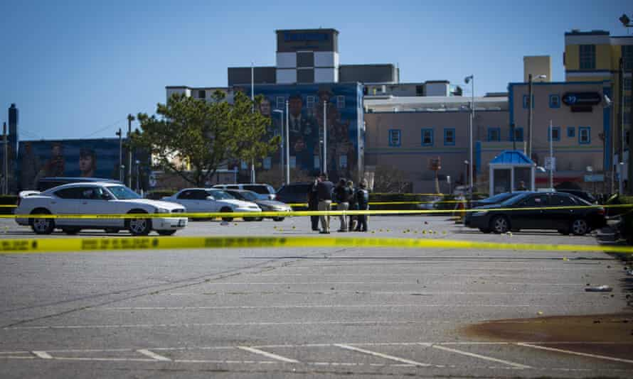 Virginia Beach police at the scene of a shooting that occurred the previous night in Virginia on 27 March.
