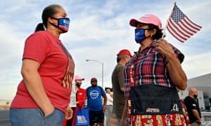 A Joe Biden supporter and Donald Trump supporter talk outside the Clark county election department on 5 November 2020 in North Las Vegas, Nevada.