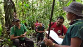 Members of Sinangoe's guardia indigena encounter illegal miners in their territory. The man wearing the baseball cap is the president of the local small-scale miners' association.