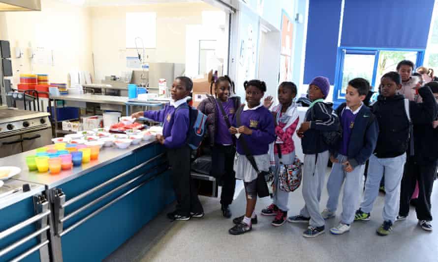 Children at Kingsmead primary school in Homerton, east London in a breakfast club run by Magic breakfast.