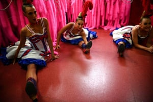 Dancers warm up in the wings before performing in a full dress rehearsal at the Moulin Rouge in Paris.