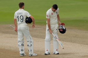 James Anderson and Chris Woakes react after the final dismissal.