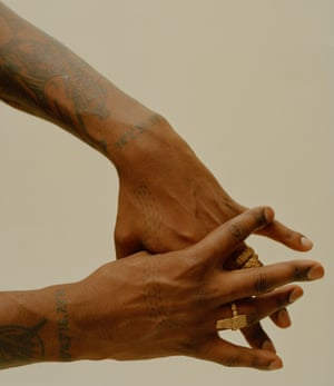 two tattooed hands