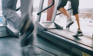 Women running on treadmills at a gym