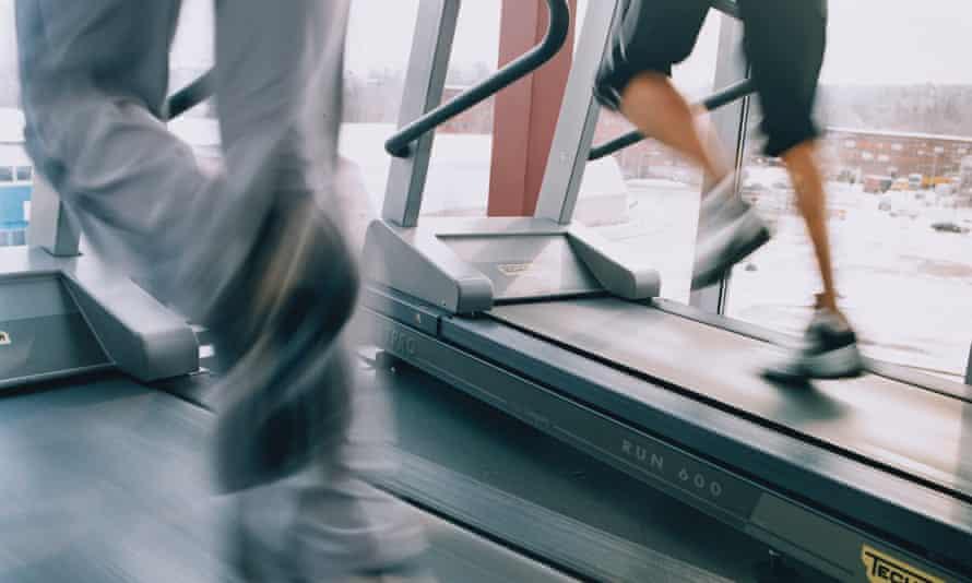 Women running on treadmills at a gym