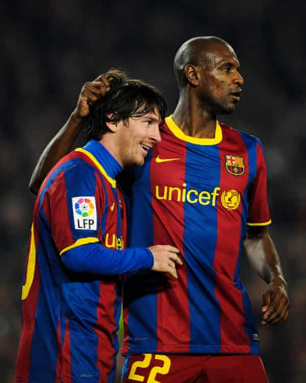 Messi and Abidal pictured playing for Barcelona in 2011.