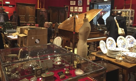 Visitors in a room of the Drouot auction house in Paris