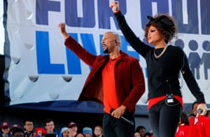 Common and Andra Day salute to the crowd