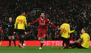 Liverpool's Mohamed Salah celebrates scoring his hat-trick before scoring a fourth in the 5-0 drubbing of Watford at Anfield.