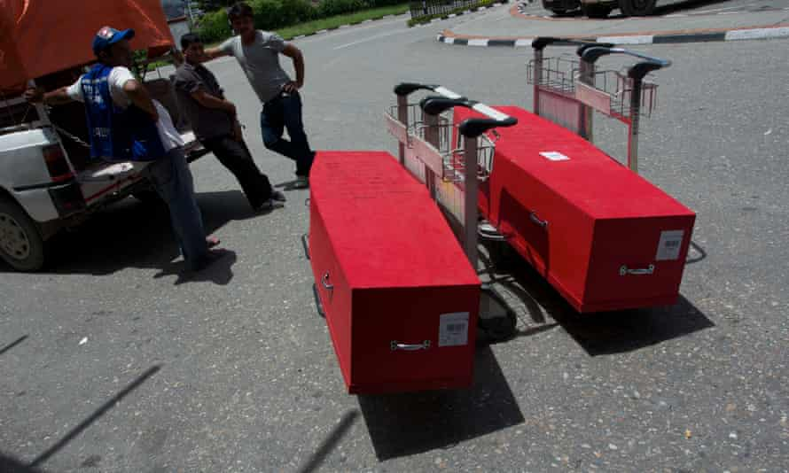 The coffins of Phatwari Chaudhari and Asharam Tharu, Kathmandu Airport