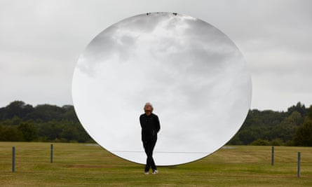 Anish Kapoor before his Sky Mirror sculpture at Houghton Hall, Norfolk, where he has a new exhibition.