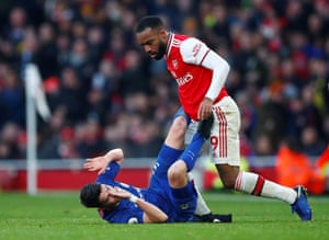 Arsenal's Alexandre Lacazette clashes with Chelsea's Jorginho.