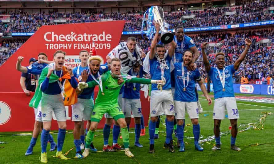 Portsmouth celebrate their shootout win.