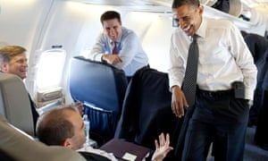 Back in the day: Here's Dan Pfeiffer standing next to Obama aboard Air Force One in 2011. The then president is joking with deputy national security adviser Ben Rhodes, sitting on the right, next to Mike McFaul, senior director for Russian and Central Asian affairs.