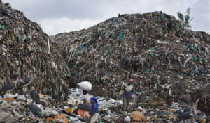 Men and women scavenge for recyclable materials at a dump in the Dandora suburb of Nairobi, Kenya